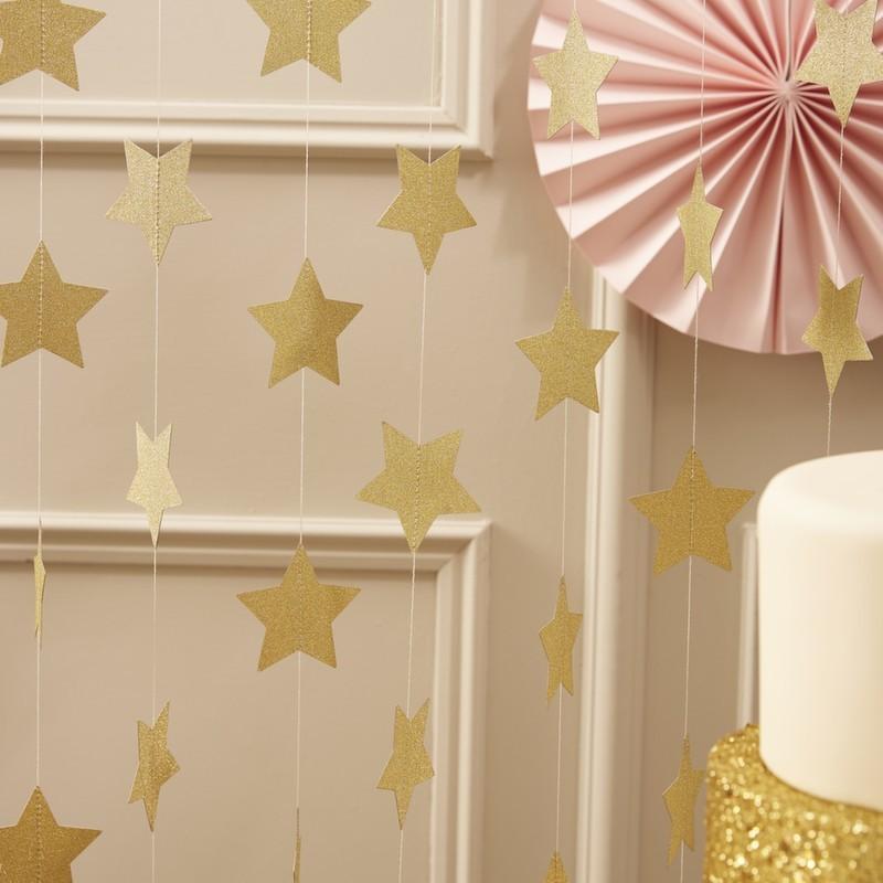 Guirnalda estrellas purpurina dorada